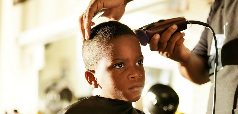 Cosmetology- a little boy getting his hair cut