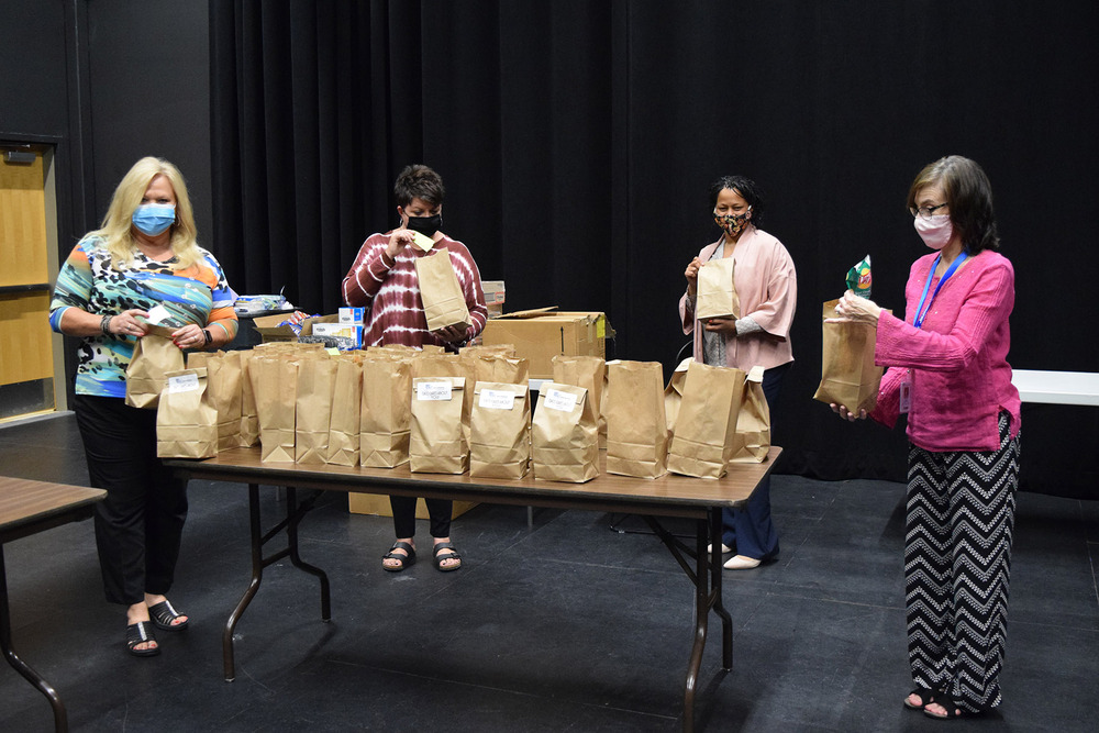 Food Pantry committee pack snack bags for students